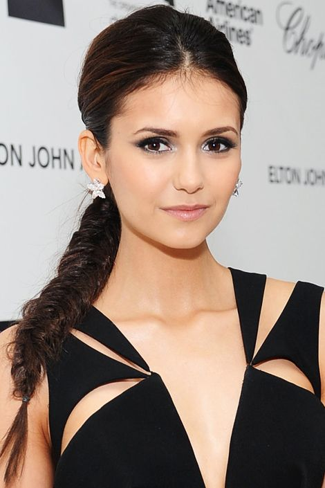 NINA DOBREV    Instead of doing a ubiquitous side-braid, weave hair into a low back-braid; if it happens to fall over your shoulder, it will be spontaneously sexy.
