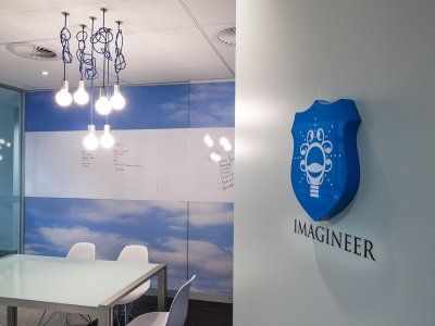 The mural and chandelier do a lot to bring this small boardroom to life.