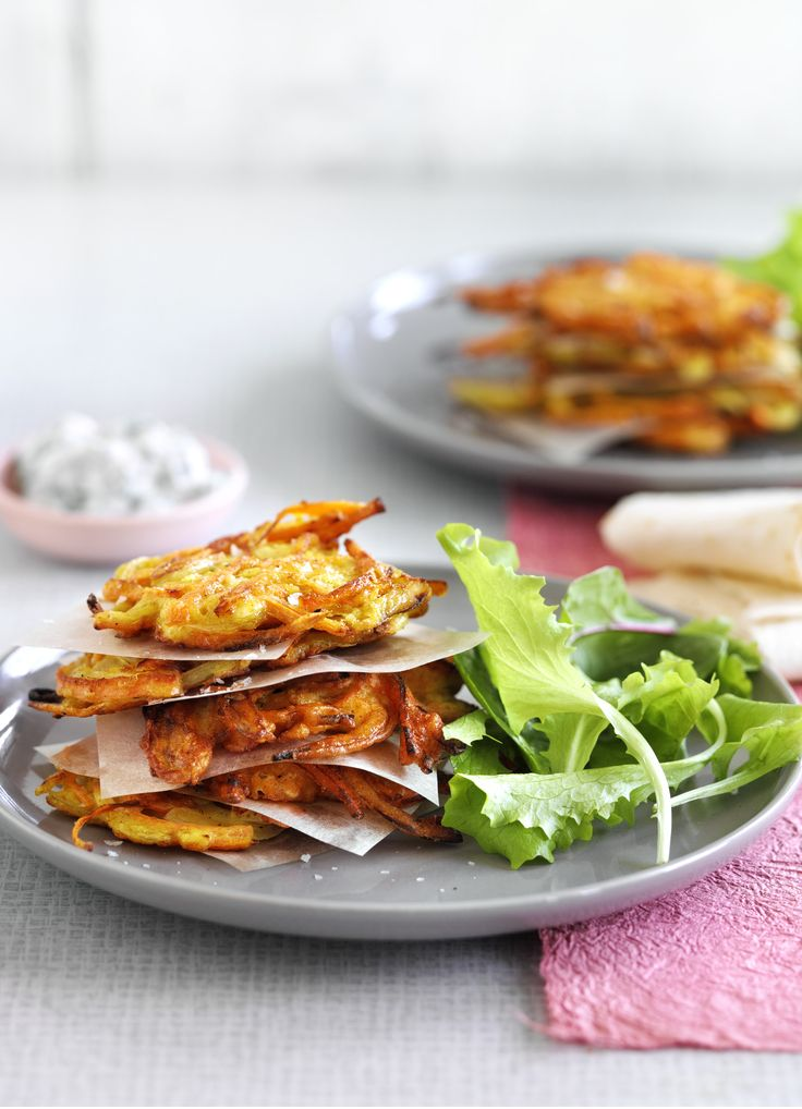 Carrot, cumin and feta fritters with coriander yoghurt: These fritters are a deliciously golden and crispy starter that vegetarians and meat eaters alike will love. Serve with herb yoghurt and salad.