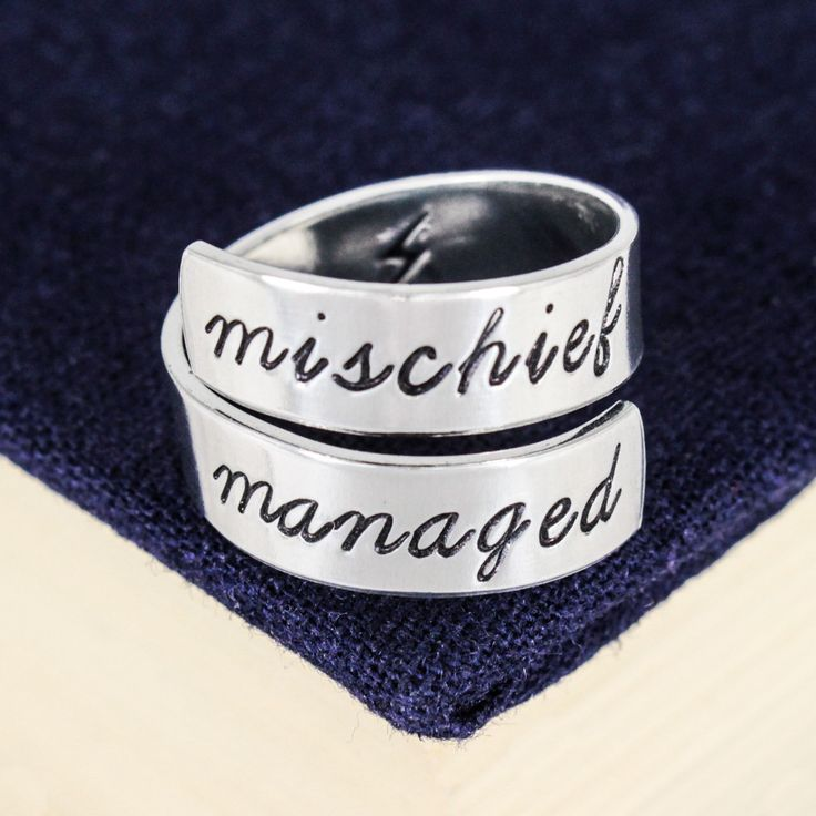 "Inspired by Harry Potter, this ""Mischief Managed"" aluminum wrap ring is hand stamped with care, one letter at a time. The rings are made out of Pure 1100 Aluminum, which is food safe and does not tarn"