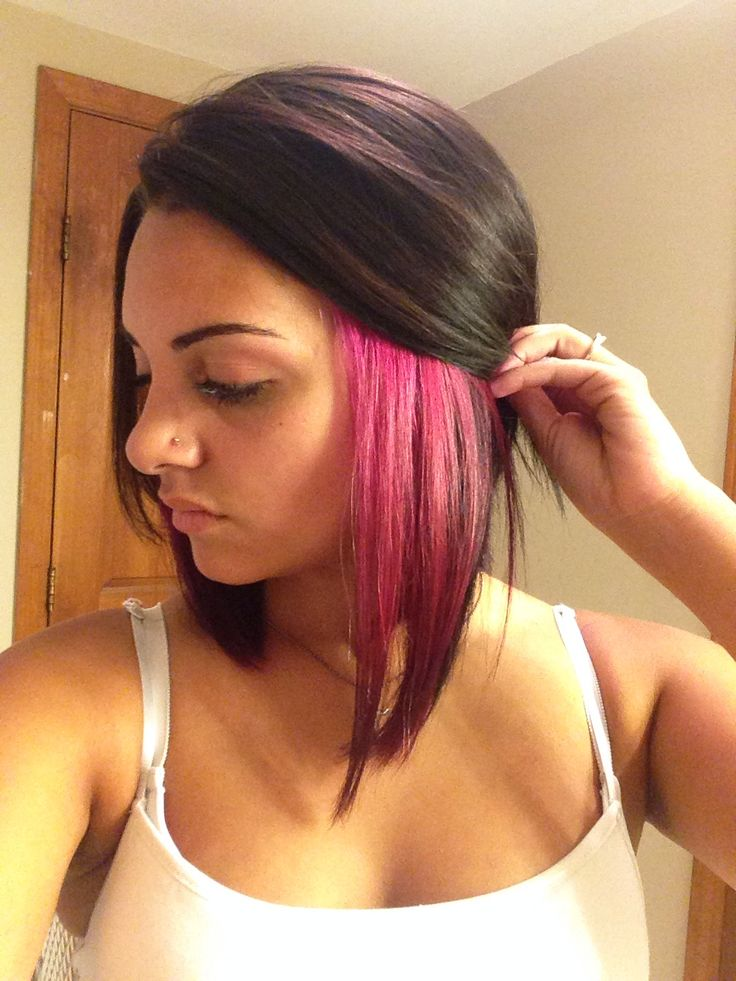 Pink peek a boo highlights on black hair bob cut with splat hair dye