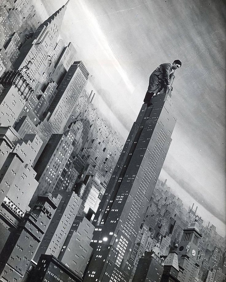 A man works atop a 32 foot tall replica of the Empire State Building in what was billed as the world's largest diorama, the Consolidated Edison (Con Ed) City of Lights exhibition at the New York...