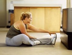 With these quick and easy exercises, you can burn 300 calories - or more - just during commercial breaks of your favorite TV shows.: How to Exercise While You Watch TV