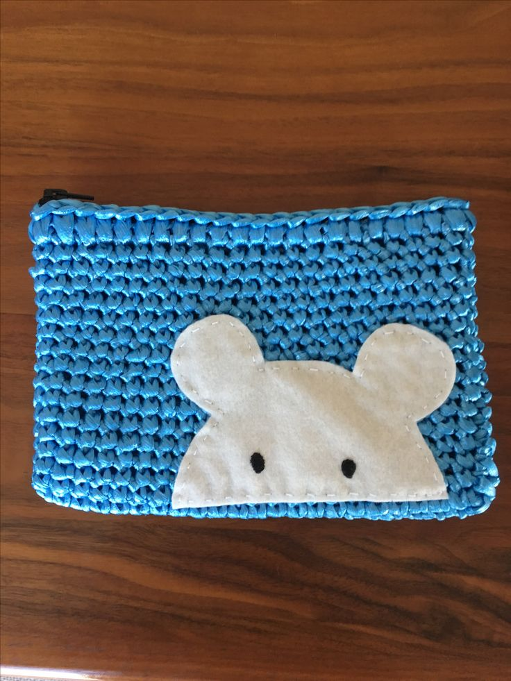 a pouch crochetted with vinyl strings!