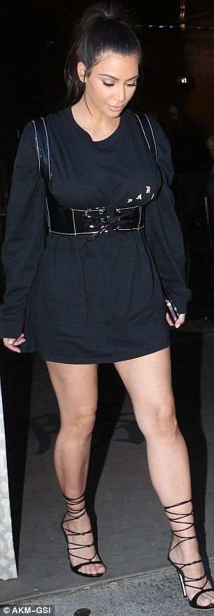 Famous curves: Kim cinched in her waist with the leather bustier with lace-up front and shoulder straps