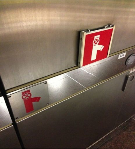 """""""We buy things we don't need with money we don't have to impress people we don't like."""": Duplicate Fire Hose Reel Sign shows Poor Design n ..."""