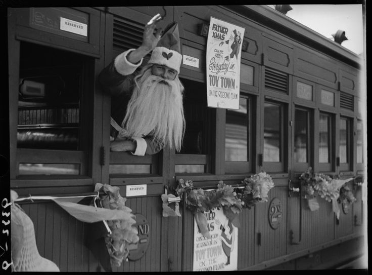 015395PD: Crowds welcome Father Christmas at the Perth Railway Station as he makes his way to Boans Toy Town, 21 November 1934 https://encore.slwa.wa.gov.au/iii/encore/record/C__Rb3419277