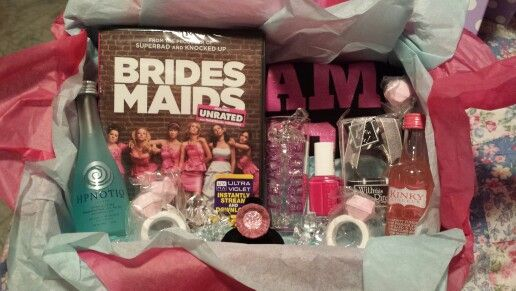 """Bridesmaid Starter Kit""- Team Bride t-shirt and shot glass, Essie nail polish in ""Bachelorette Bash,"" Bridesmaids DVD, Kinky, Hypnotique, candy engagement rings, engagement ring keychain all in a cute box!"
