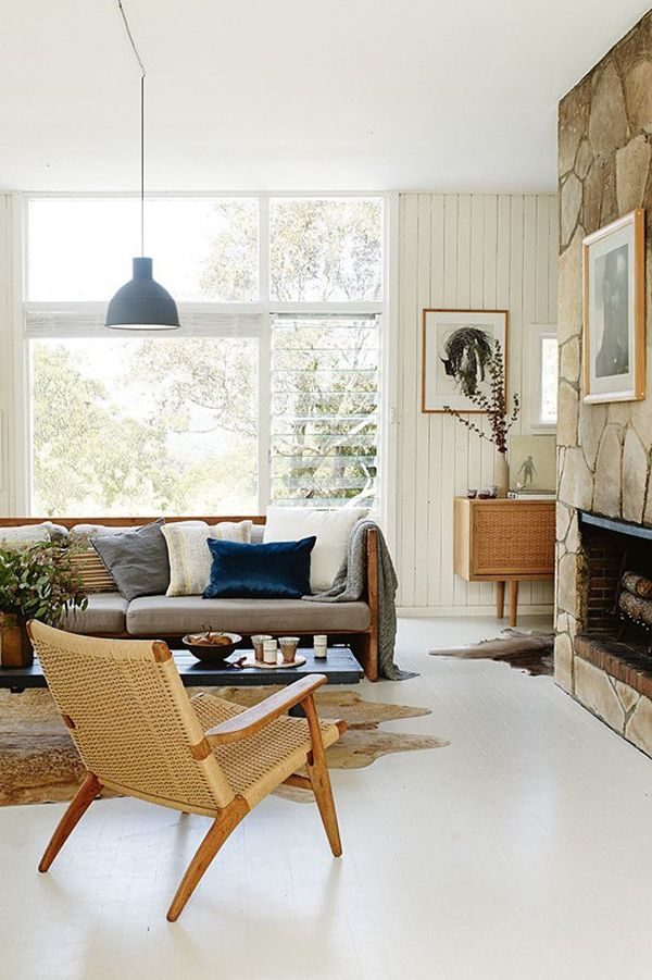 mixture of furniture and artwork compliments the bright white floors, walls and ceiling