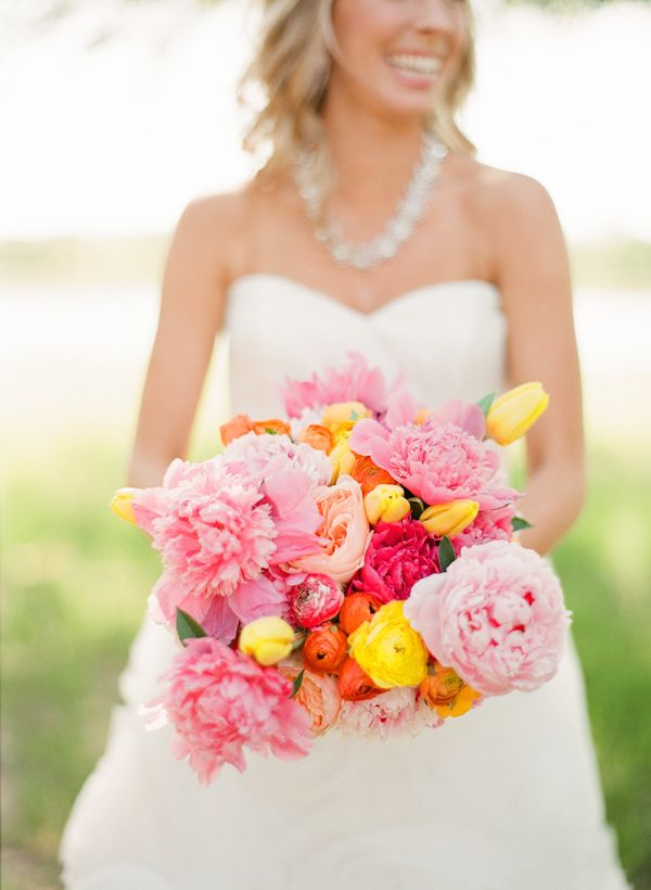 cheerful Texas wedding flowers by Bows & Arrows, photo by Taylor Lord Photography | via junebugweddings.com