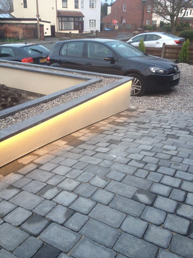 Hidden LED strip lights in the coping stones, lights the path really well!