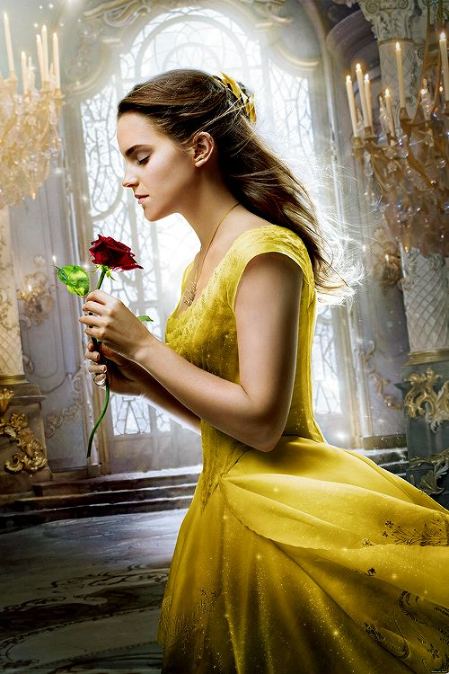 """Emma Watson as Belle in """"The Beauty and The Beast"""" promotional poster."""