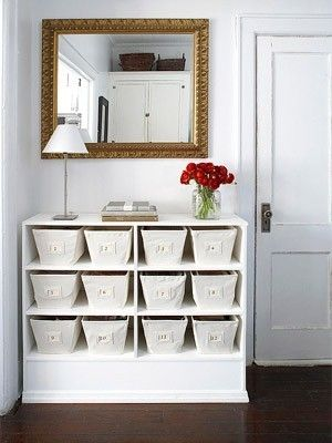 Old dresser without drawers is repurposed...love the canvas storage bins.