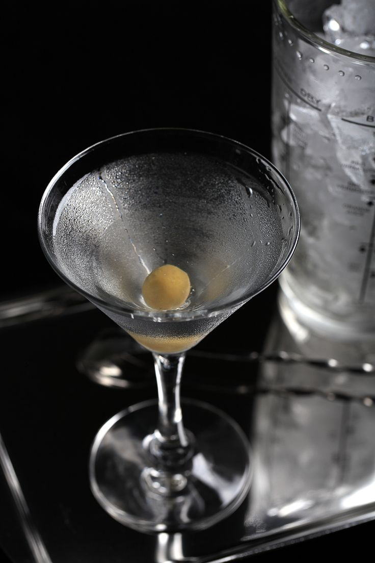 In&Out Extra Dry Martini Cocktail garnished with an anchovy stuffed olive| ScienceOfDrink.com