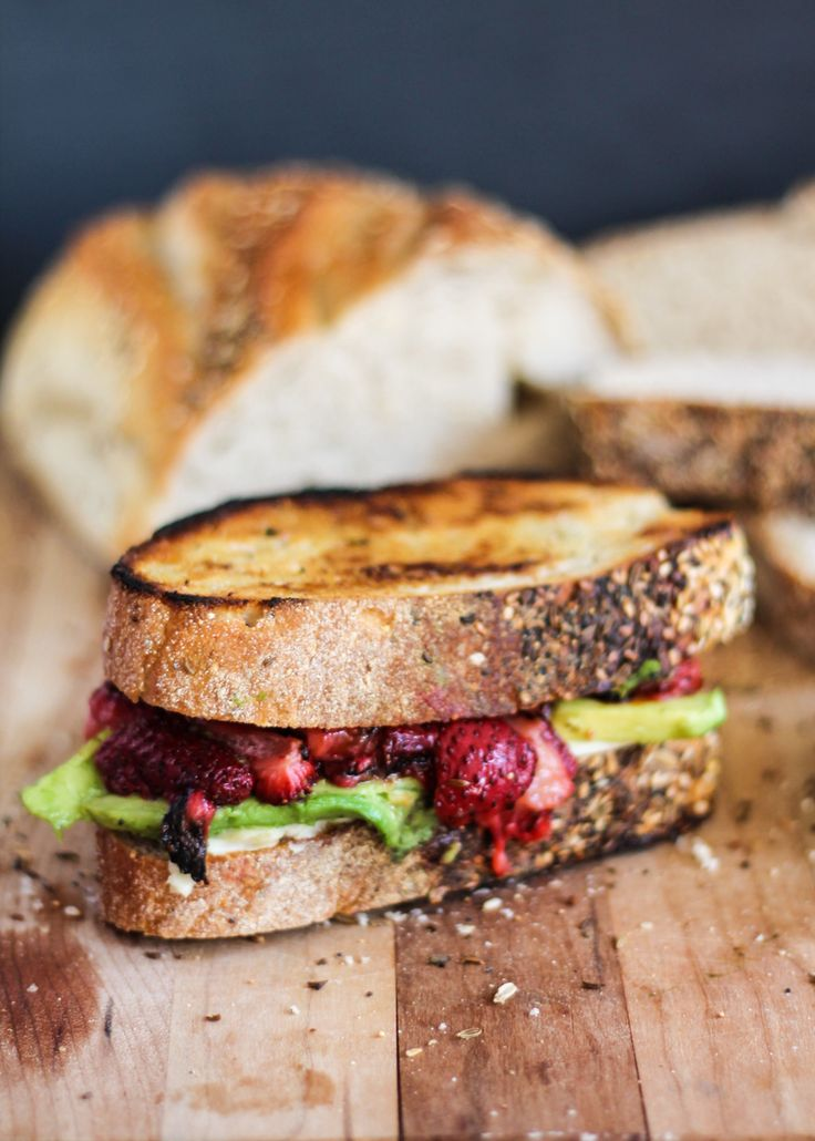 Delicious grilled cheese with juicy roasted strawberries and ripe avocado. You need this in your life.