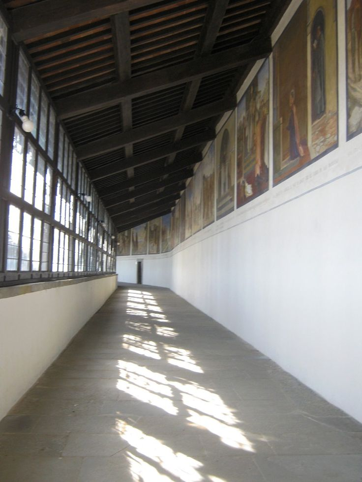 The corridor of the Stigmata at La Verna Sanctuary, closed by a line of windows to protect the friars from bad weather during their daily procession to the Chapel of the Stigmata