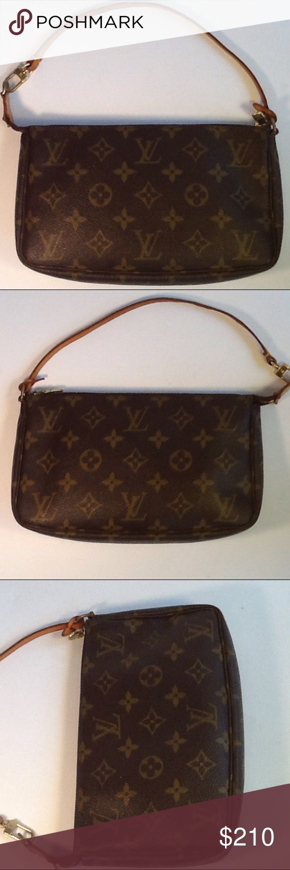 Authentic Louis Vuitton Monogram Pochette Hanbag. The strap showed signs of used. The canvas and inside linen are good. The bag was made in France with a date code VI 0090. Louis Vuitton Bags Clutches & Wristlets