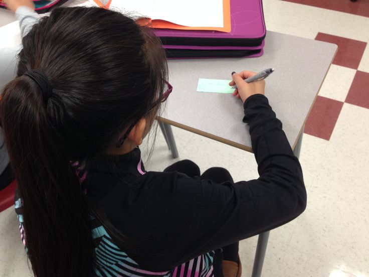 Students taking a moment to write down what they are thankful for during a quiet moment in Mr. Burns' homeroom.