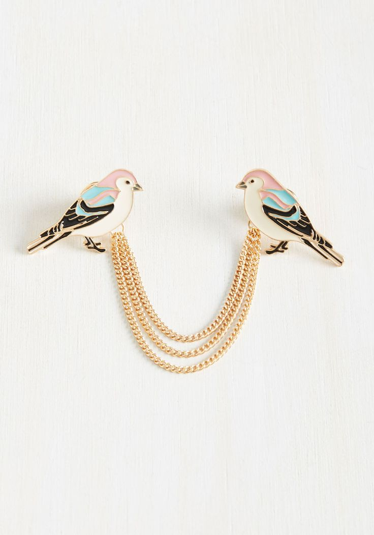 Be the star of the soiree by showing up in this ModCloth-exclusive collar pin. More exciting than the snacks you bring, this metal accessory flaunts two pastel enamel birds - trimmed with tiered golden chains - offering a vintage-inspired touch to your party attire!