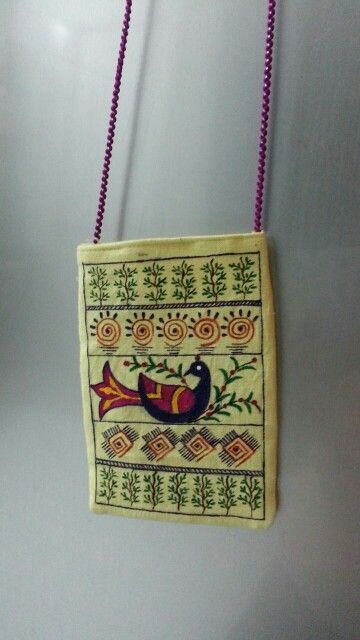 Madhubani style peacock hand painted on a Mobile bag.