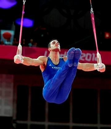 Danell Leyva competes on the still rings as part of Team USA during the men's gymnastics all-around final at the London Olympics.