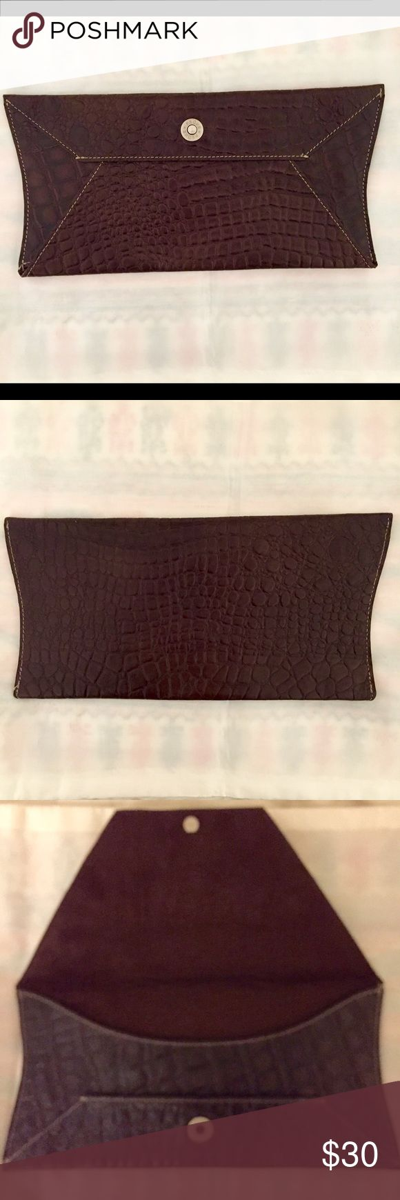 "Prune of Buenos Aires Envelope Clutch Prune of Buenos Aires, Argentina, Envelope Clutch fashioned from deep brown leather embossed in reptile pattern. Accent stitching is tan. Bag fastens in front with a snap bearing Prune logo. Measures 12""x5-1/4"". Never used and in immaculate condition. Prune of Buenos Aires Bags Clutches & Wristlets"