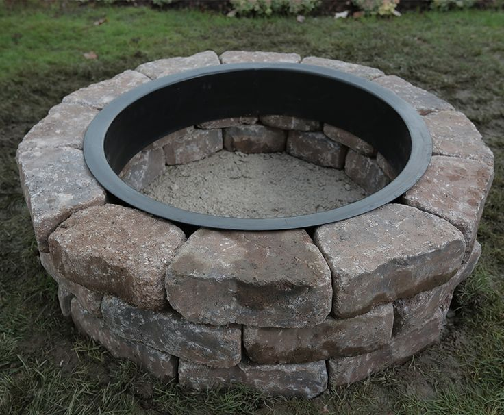 How to Build a Fire Pit Ring: The following instructions will show you how to install a fire pit ring kit.  Inserting the metal ring and adding lava rock. Cozy up to a warm fire with a new backyard fire pit ring.