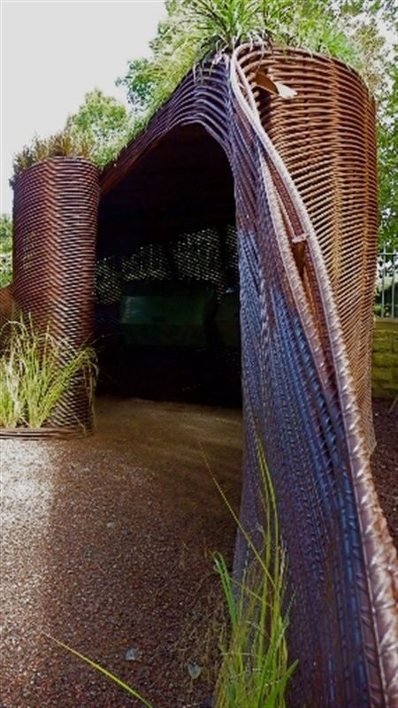 Rebar composting shed with living roof. A modern take on willow weaving in the garden (via Water Gems)