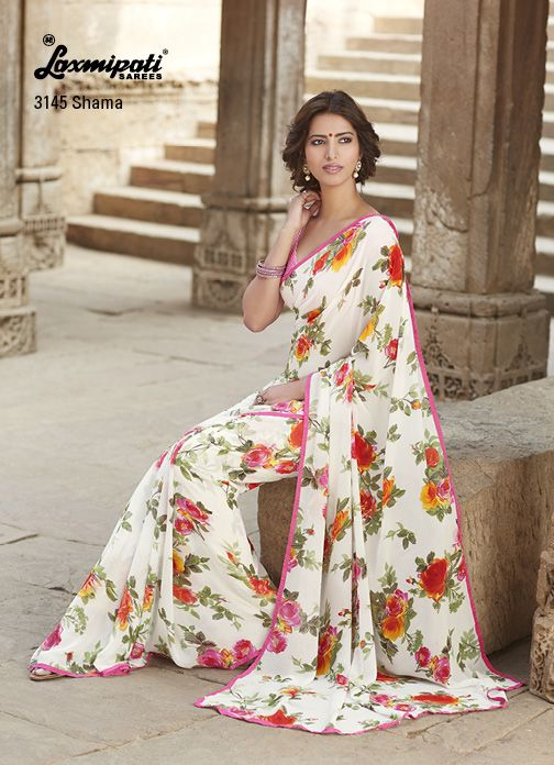 Shop the floral print white georgette saree with pink piping border & criss cross printed blouse piece