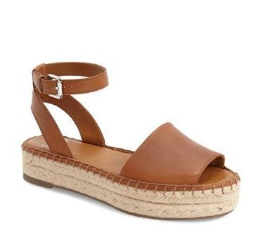 Sarto by Franco Sarto Ravenna Espadrille Platform Sandal has a distinctive ankle strap and contrasting stitching. Details: - Peep toe - Approx. 1 1/4 inch woven platform heel - Adjustable ankle strap