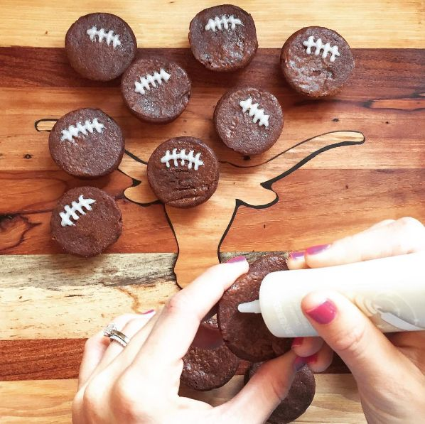 Super easy football party snacks! All of the ideas are really easy, quick to make, and adorable (like these brownie bite footballs)! No need to simply open a bag of chips and dump dip in a bowl when you can make an easy, football-themed treat in minutes. Click or visit FabEveryday.com for all the ideas, and make sure to pin these ones for your Super Bowl party, game watching party, or even a football-themed birthday party! #fabeveryday #football #superbowl #food