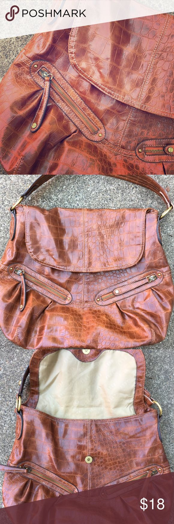 Elle brown purse! Roomy super cute brown purse, lots of zippers and pockets. In gently used condition. Only flaw is a mark inside as shown in photo. Outside is in excellent condition. Elle Bags