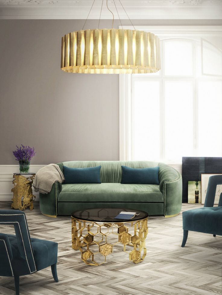 Midcentury living room ideas by @brabbu   Colorful upholstery with WALES green velvet two seat sofa , NAJ blue lounge chairs, MANUKA brass center table with top glass, CAY side table and AURUM brass suspension lamp   #livingroomideas #livingroomdecor #livingroomfurniture