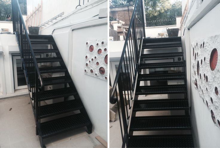 Satisfied couple with our RSG4600 fabricated staircase with handrails, professionally fitted to a residential project in Kensington.