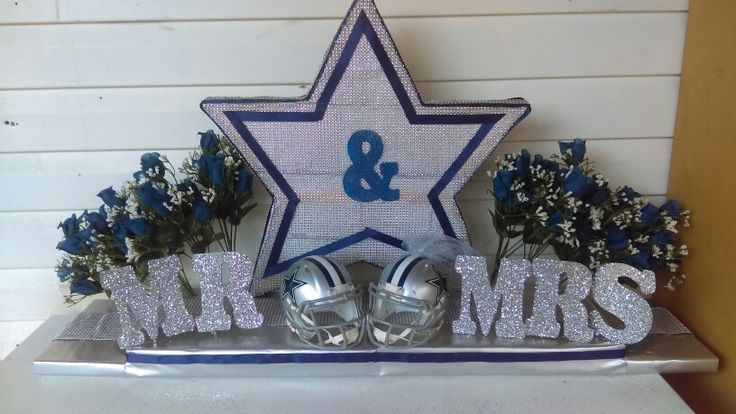 Dallas cowboy theme wedding  What you need styrofoam, jewel ribbon letters glitter flowers 2 helmets, blue ribbon an syilver wraping paper!