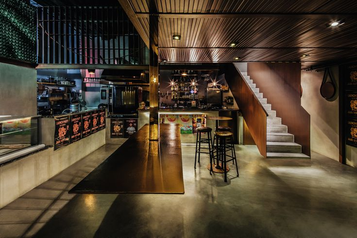dongqi architects designs le poulet eatery in china with an industrial flair