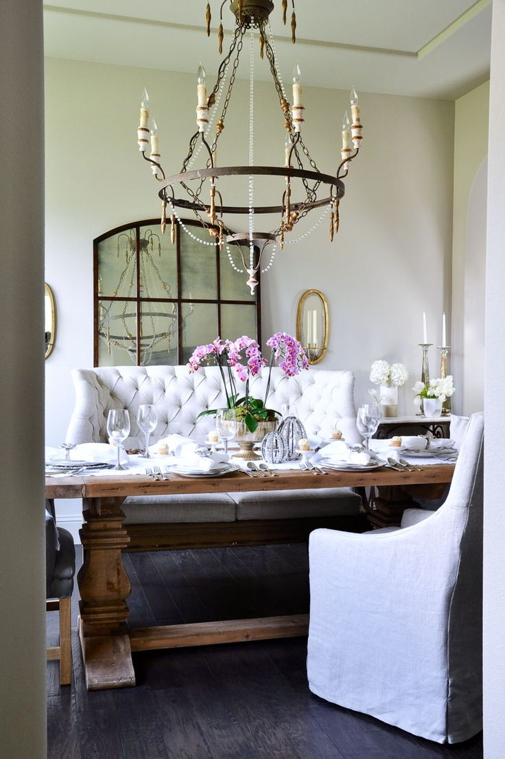 Love the cozy look in this dining room, I am sure it is the tufted bench seating, also like Citrine Living's DR with a similar set up with tufted sofa.