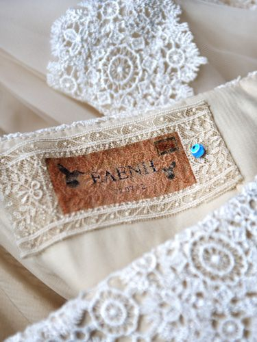 label on wedding dress with the name of the bride and the wedding date...and something blue!