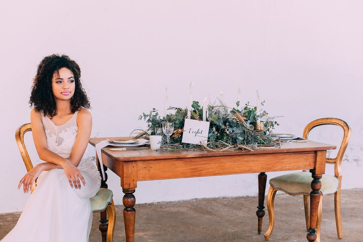 WEDDING INSPIRATION – Wooden table with gold chairs and greenery