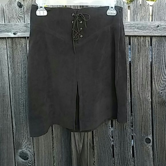 Copper Key Faux Suede Skirt A very cool chocolate brown skirt that looks almost like real suede with none of the possible guilt and easier to maintain as well. It features an accentuated V style waistline design with a corset style lace up for added allure and a zipper on the left side. The bottom hem has an intentional slit that runs a few inches up to make it a bit more daring. Hardly worn, Polyester/Spandex blend. Made in China. Copper Key Skirts Mini