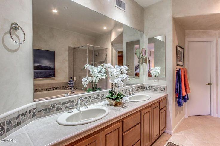 Craftsman Full Bathroom with limestone tile floors, Stone Tile, Raised panel, Double sink, Custom Mirrors, Radford Cabinets