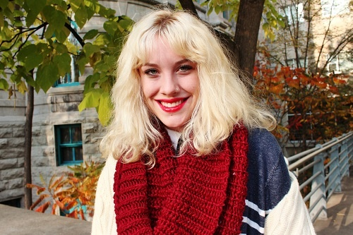 Blonde hair, red lips, circle scarf, striped sweater, cable knit.     STYLE ADVICE OF THE WEEK: Traditional With A Twist