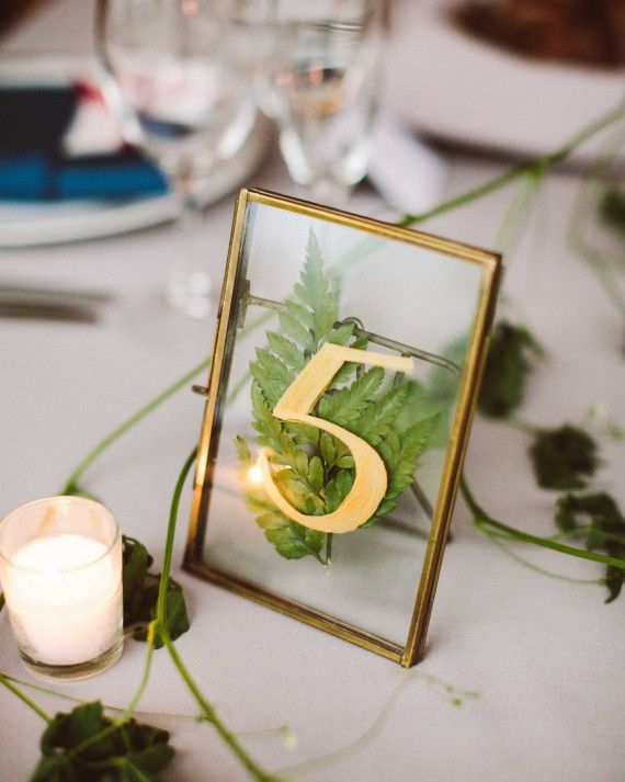 ink revival collaborated with brita olsen to create unique natural table numbers with pressed flowers