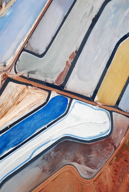 landscape-photo-graphy: These Beautiful Ponds in the Utah Desert Are Not Photoshopped. Located in Moab, Utah, these stunning deep blue body of waters are potash evaporation ponds. Although they are an artificial creation, the drying ponds' purpose is used as the world's largest producer of potassium chloride or potash. Known as the most important fertilizer in the world, the potash is harvested deep within the Earth.