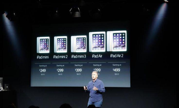 Apple Senior Vice President of Worldwide Marketing Phil Schiller shows off the iPad line.