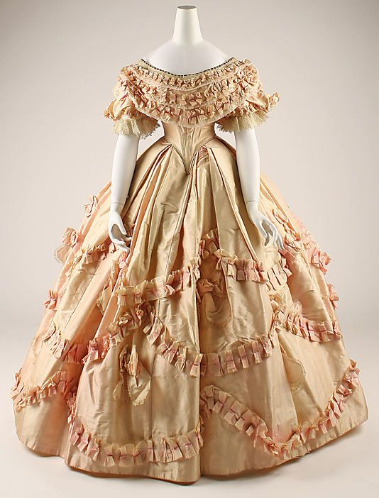 Dress (1860-61)    Quintessential 1860s ruched ball gown (with bows!).  Good example of large scale trim to fill the space.