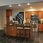 retro kitchen floor ideas with black tile floor on the kitchen room decor and brown wooden countertop also wooden kitchen cabinet