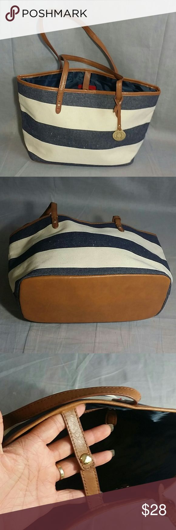 """Tommy Hilfiger totes Bag Multi-color Canvas Item is in a good condition, NO PETS AND SMOKE FREE HOME. Measurements strap Drop 8"""" height 9 """" Length 15.5"""" Tommy Hilfiger Bags Totes"""