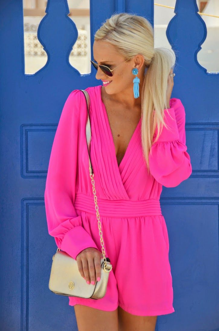 Neon Pink Romper with turquoise earrings