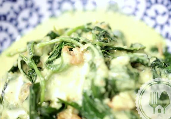 SAYUR DAUN SINGKONG. Boiled cassava leaves somewhat wilted from being too lenient when boiled with coconut milk.